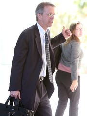 Kevin Hamilton, a lawyer for the Ron Barber campaign, leaves the Evo A. DeConcini U.S. Courthouse in Tucson on Nov. 26 2014.