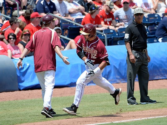 Florida State's John Sansone rounds third base after hitting a home run in Sunday's ACC Championship game against North Carolina State.