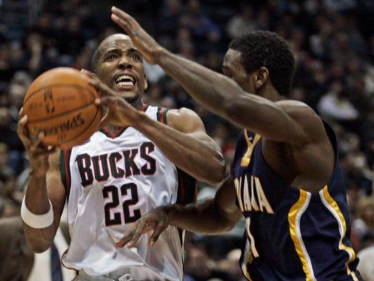 Milwaukee Bucks' Michael Redd drives for the basket