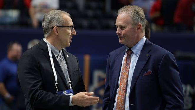 Then-Auburn athletic director Jay Jacobs, right, talk to Southeastern Conference commissioner Greg Sankey, left, before the SEC Championship game at Mercedes-Benz Stadium in Atlanta on Dec. 2, 2017.