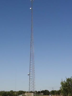 A tower in Liberty Hill transmits and receives radio frequency signals throughout Williamson County from the antennas visible at the top.