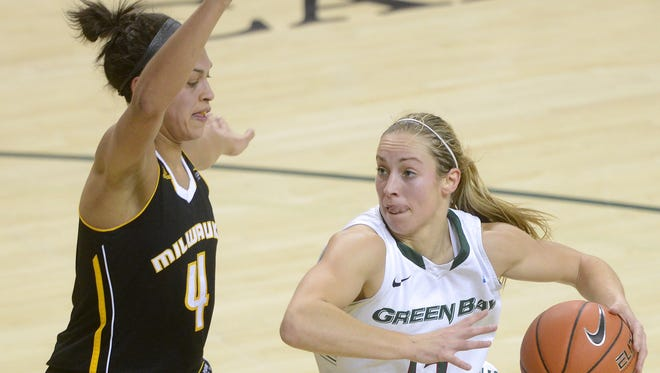 UWGB guard Megan Lukan makes a move around UW-Milwaukee's Ashley Green in the first half at the Kress Events Center in Green Bay.
