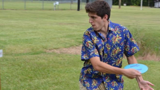 Michael Pascarella spends time at Forrest County Agricultural High School's new disc golf course on campus.