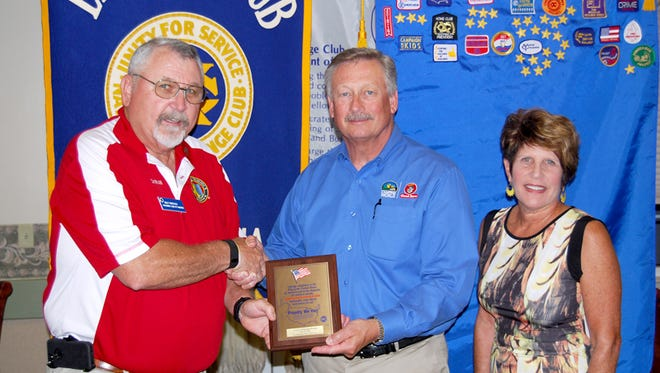 """From left, Billy Wineholt, Exchange Club of Hanover President, recognized Dan and Karen Saltzgiver of Camping World RV Sales as the 2016 recipient of the """"Proudly We Hail"""" Award."""
