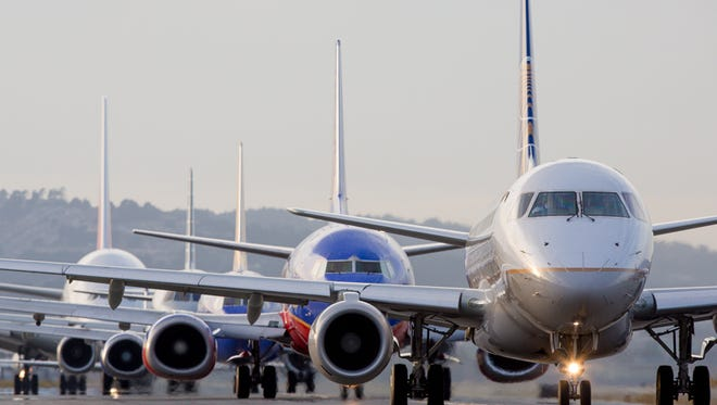 Jets line up for departure during the early evening rush at San Francisco International Airport on Oct. 23, 2016.