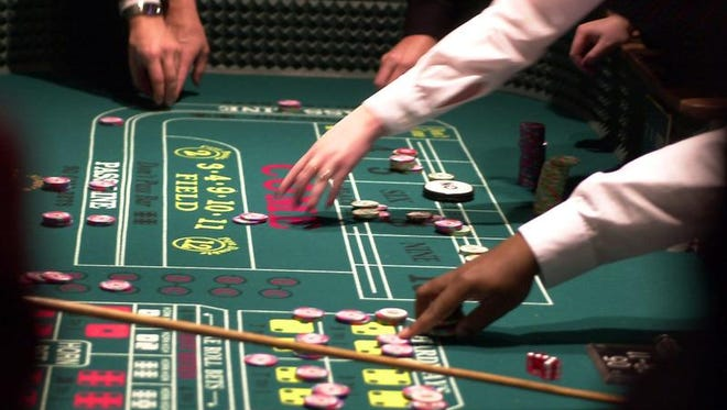 Table operators reach for chips at the Seneca Niagara Casino owned by the Seneca Nation of Indians.