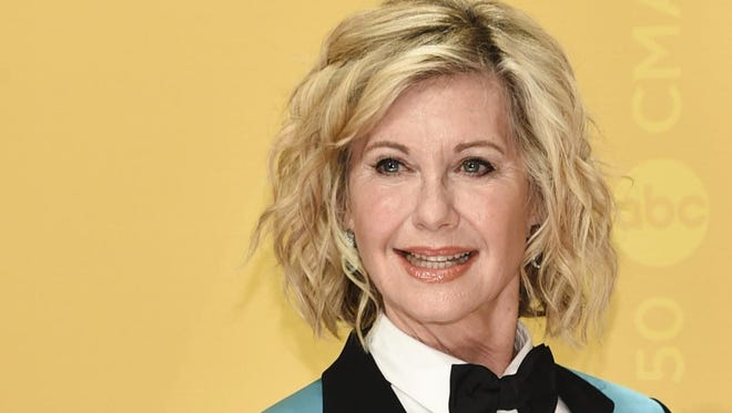 "Actress and singer Olivia Newton-John says she has breast cancer and is canceling her June tour. The 68-year-old singer announced Tuesday that she initially thought she was suffering from back pain, but learned it was ""breast cancer that has metastasized to the sacrum."""