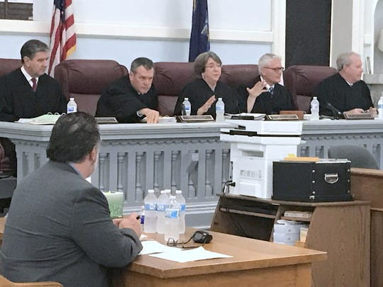 Presiding Justice Elizabeth Garry explains to spectators why the state Supreme Court Appellate Division, Third Judicial Department convened a special session Friday at the Chemung County Courthouse in Elmira. From left are justices Robert C. Mulvey, John C. Egan Jr., Garry, Michael C. Lynch and Phillip R. Rumsey.