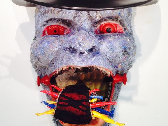 """Suprina Kenney, """"Tipping Point--4th Stage of Capitalism,"""" sculpture composed from wax, foam, street trash, doll parts, wood, fabric, detritus, paper, epoxy and paint"""