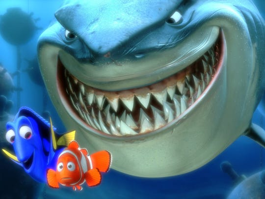 "Marlin and Dory face an ocean full of perils in their efforts to rescue Nemo, including a close encounter with a most unusual group of great white sharks in the film ""Finding Nemo."""