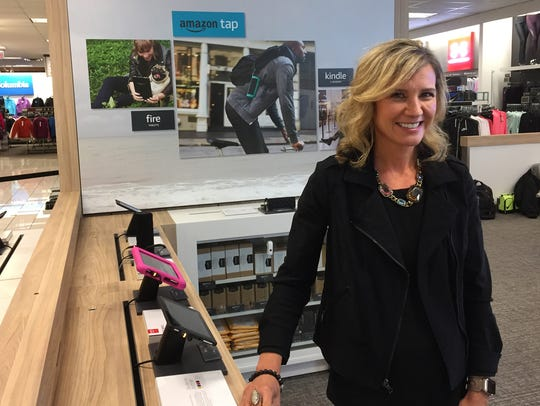 "Kohl's CEO Michelle Gass shows off the new Amazon ""smart home"" department at the Kohl's store in Chicago's Bucktown neighborhood in 2017. Kohl's is ending the in-store shops but expanding its partnership with Amazon."