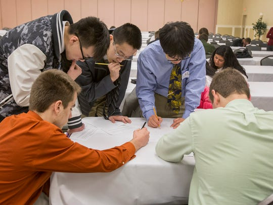 Salesianum competitors work through the team question as they compete in the Math League High School Invitational.