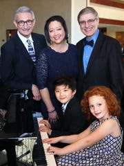 The performing doctors/ Dr. Anthony Bassanelli, Dr. Celeste Amaya, Dr. Rainer Bergmann, seated Jadon Wu and Kailey Amaya.