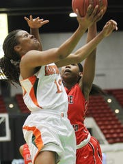 Dunbar's Kiara Desamours shoot a lay-up under the defense