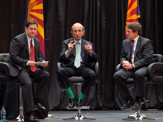 Arizona Gov. Doug Ducey talks about education with Joel Klein, former chancellor of the New York City Department of Education and Paul Pastorek former Louisiana State Superintendent of Education, right, during The Governor's Leadership Summit in Glendale at University of Phoenix Stadium on May 14, 2015.