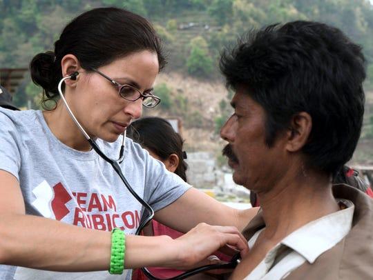 Painted Post native Dr. Sapana Pathak Adhikari examines