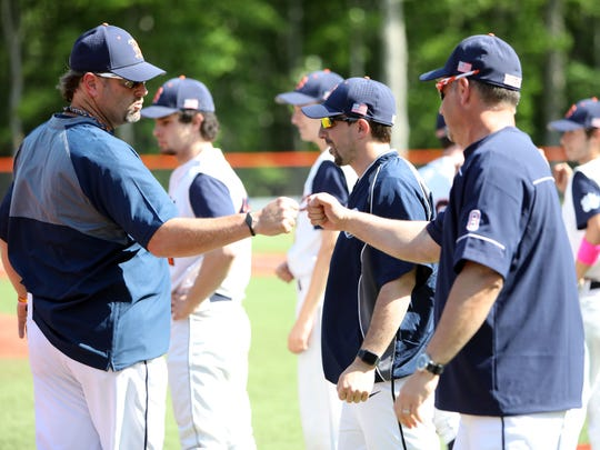 Briarcliff baseball head coach John Schrader, left, with assistant coaches Walter Kowalczyk, center, and Ken Santoianni before the start of the semifinal game against Putnam Valley May 23, 2018.