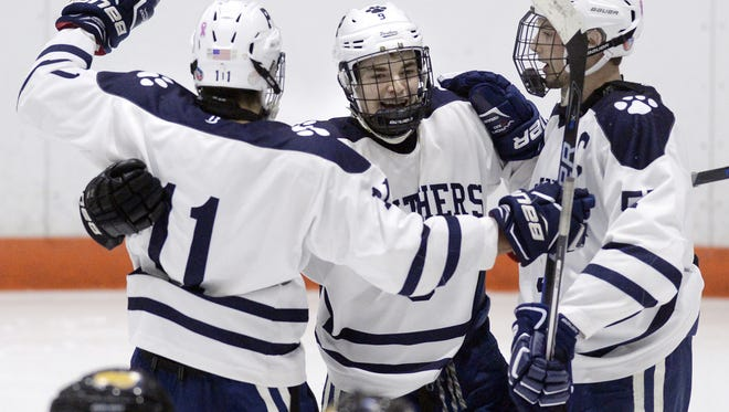 Pittsford's Brett Sauer, center, celebrates his second period goal with teammates Patrick Kompare, left, and Connor Haims during a regular season game against the Greece Thunder at RIT's Ritter Ice Arena on Tuesday, Jan. 10, 2017. Pittsford beat the Greece Thunder 5-1.