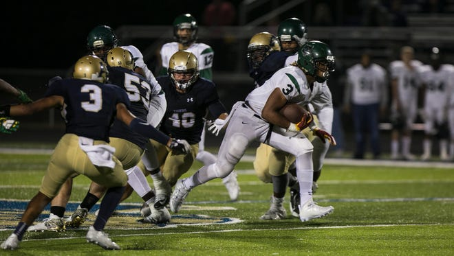 October 20, 2017 - Cordova running back Jeremy Banks (3) gains yardage in the fourth quarter against the Arlington Tigers at Arlington High School on Friday.
