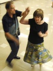 Robert and Twila Allison practice the dance moves taught to them by Carolyn England Thursday night at Holy Trinity Lutheran Church.