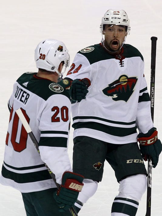 Minnesota Wild's Ryan Suter (20) celebrates with teammate Matt Dumba (24) after scoring a goal against the Florida Panthers during the first period of an NHL hockey game, Friday, Dec. 22, 2017, in Sunrise, Fla. (AP Photo/Luis M. Alvarez)