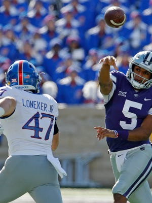 Kansas State quarterback Alex Delton (5) passes over Kansas linebacker Keith Loneker Jr. (47) during the first half of an NCAA college football game Saturday, Nov. 10, 2018, in Manhattan, Kan. (AP Photo/Charlie Riedel)