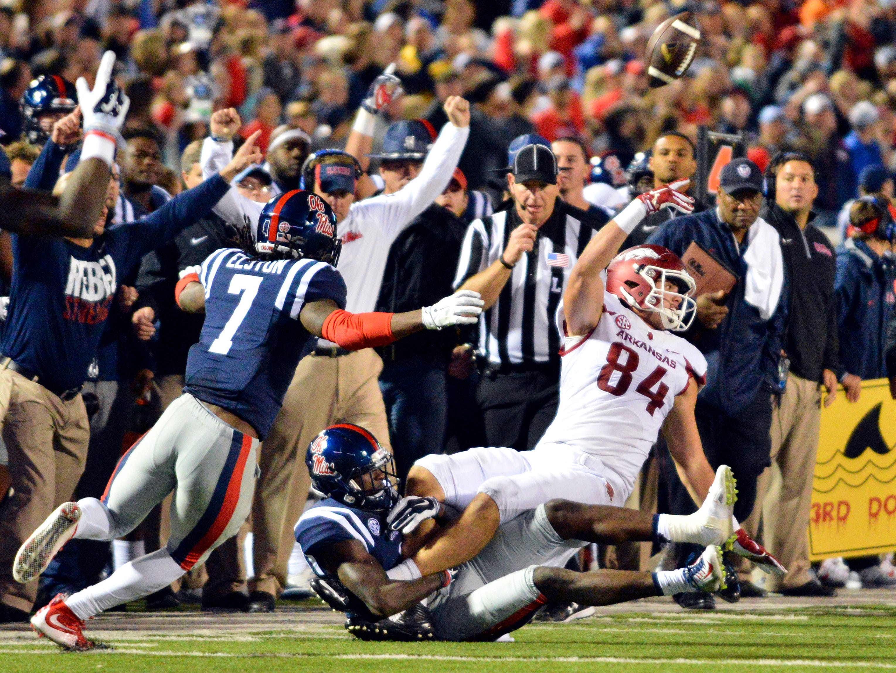 Arkansas tight end Hunter Henry (84) laterals the ball as he is tackled by Mississippi Rebels defensive back Tony Bridges (1) during overtime at Vaught-Hemingway Stadium. Arkansas won 53-52.