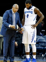 Memphis head coach Tubby Smith (left) talks with forward Raynere Thornton (right) during a break in action against Tulane at the FedExForum in Memphis Tenn., Tuesday, January 9, 2017.