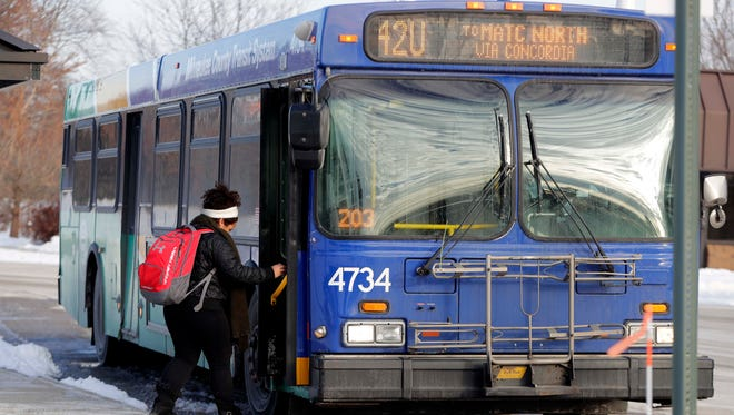 Students at MATC North campus in Mequon board the Route 42U bus. County Executive Chris Abele said that the bus route and eight others will not be eliminated this year as planned.