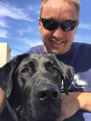 Las Cruces resident Josh Dunne and his service dog,