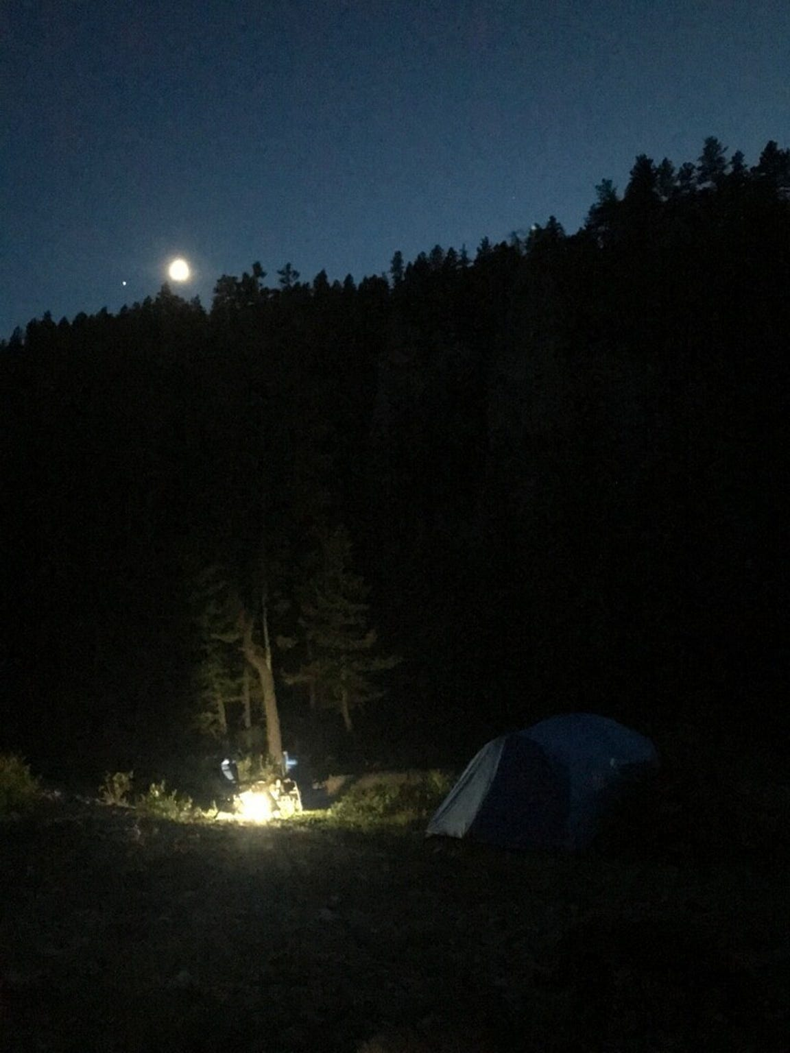 Hikers make camp on the banks of dried up Rock Creek.