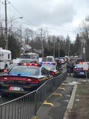 Traffic builds up on Route 306 near the cemetery ahead