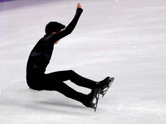 United States' Nathan Chen falls in the men's single short program team event at the 2018 Winter Olympics in Gangneung, South Korea, Friday, Feb. 9, 2018. (AP Photo/Julie Jacobson)