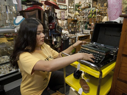 Carolyn Moscato checks out an antique typewriter in her booth at Honey Hole Antiques in Keyport.