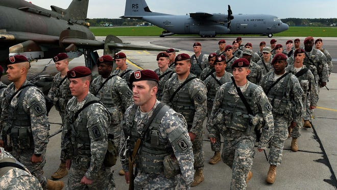 The first U.S. troops arrive at the airport in Swidwin, Poland, on April 23, 2014.