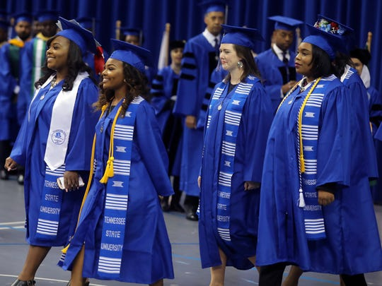 Graduates enter during the processional for TSU's graduation