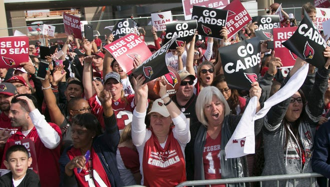 Cardinals fans cheer on the team during the send-off before heading to North Carolina for the NFC Championship at Phoenix Sky Harbor in Phoenix on Jan. 23, 2016.
