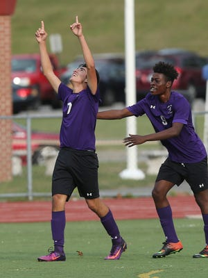 New Rochelle's Cristian Valencia (7) celebrates with teammate Stevenson Dievdonne (9) after his second goal of the first half against Arlington in the boys soccer Section 1 Class AA championship game at Lakeland High School in Shrub Oak High School Oct. 29, 2016. New Rochelle won the game 3-0.
