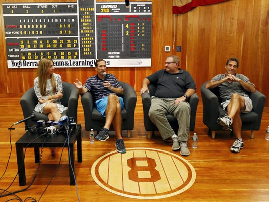 Yogi Berra's oldest granddaughter Lindsay Berra, far left, sits with his sons, from left, Dale, Larry and Tim while talking about the passing of the New York Yankees hall of fame catcher at the Yogi Berra Museum on Thursday in Little Falls, N.J. Berra died Tuesday at the age of 90.