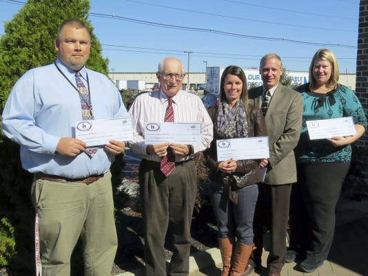 Innovative Technology Grant recipients are, from left, John Root of Greencastle-Antrim Elementary School, Mathern Mellott of Fannett-Metal High School, Erin Martin and Rick Burkett of James Buchanan High School, and Krystal Johnson of Shippensburg Area Middle School. Not pictured is Johnson's SAMS partner Betsy Riep.