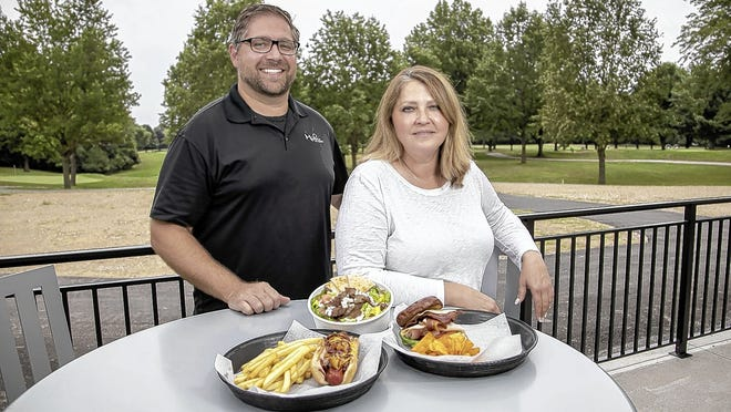 Milo's Grill owners Louie Pappas and Demetra Stefanidis are pictured July 30 on the patio outside the Champions Golf Course clubhouse, 3900 Westerville Road in northeast Columbus.