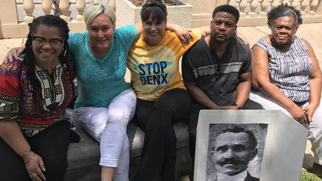 From left, Sonya Patrick, head of the Wilmington chapter of the Black Lives Matter movement; Meg MacRae, great-granddaughter of Hugh MacRae; Beth Kline-Markesino of North Carolina Stop Gen-X In Our Water; Josiah Bennetone, director of the New Hanover County chapter of the National Black Leadership Caucus; and Ernestine Washington, vice-president of the New Hanover County chapter of the National Black Leadership Caucus. Bennetone holds a photograph of the Dr. Rev. J. Allen Kirk, a national Civil Rights leader who was pastor of Central Missionary Baptist Church during Wilmington's 1898 Massacre