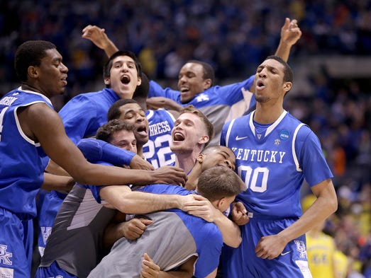 The Kentucky Wildcats celebrate their 75-72 win over Michigan in the NCAA Division1 Men's Basketball Championship Midwest Regional championship game Sunday, March 28, 2014, at Lucas Oil Stadium.