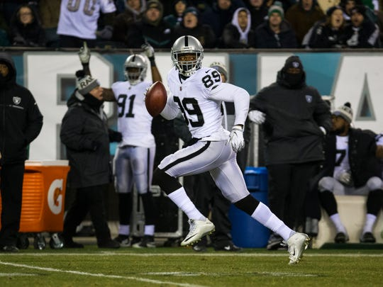 Amari Cooper, shown scoring a touchdown for the Oakland Raiders against the Eagles last Dec. 25, had five catches for 58 yards and a touchdown in his Cowboys' debut last Sunday.