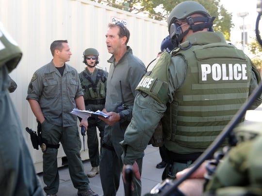 David Manning briefs SWAT team members before Thursday's shooter drill at Santa Paula High School.