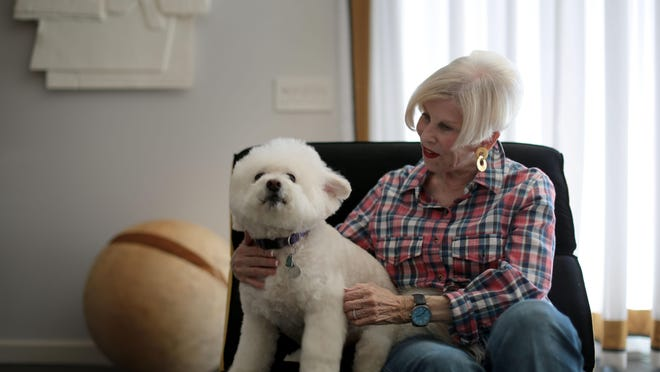 Rabbi Sally Olin the retired rabbi rom Temple Isaiah with her dog Barney at their Palm Springs home on Friday. She has started up a new service to provide pet memorials and grief counseling.