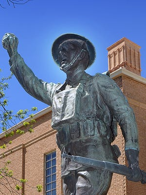 A bronze statue honoring U.S. veterans of World War I stands on the front lawn of Memorial Auditorium. The United States joined the war 100 years ago.