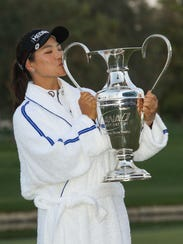So Yeon Ryu kisses the trophy after winning the ANA