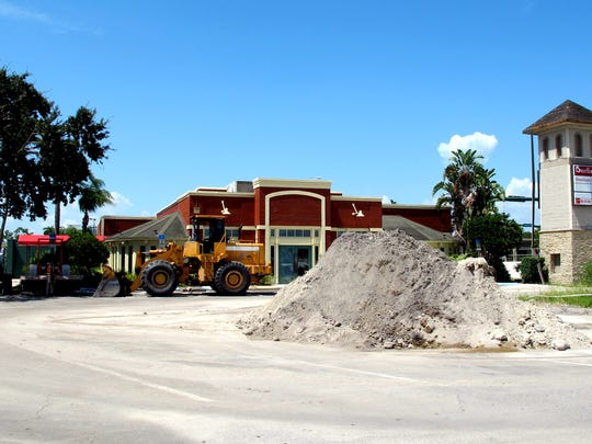 The parking area near the former longtime Chili's Grill & Bar in the middle of Park Shore Plaza is a staging area for landscaping upgrades and construction materials for a shopping center that is undergoing a complete makeover.