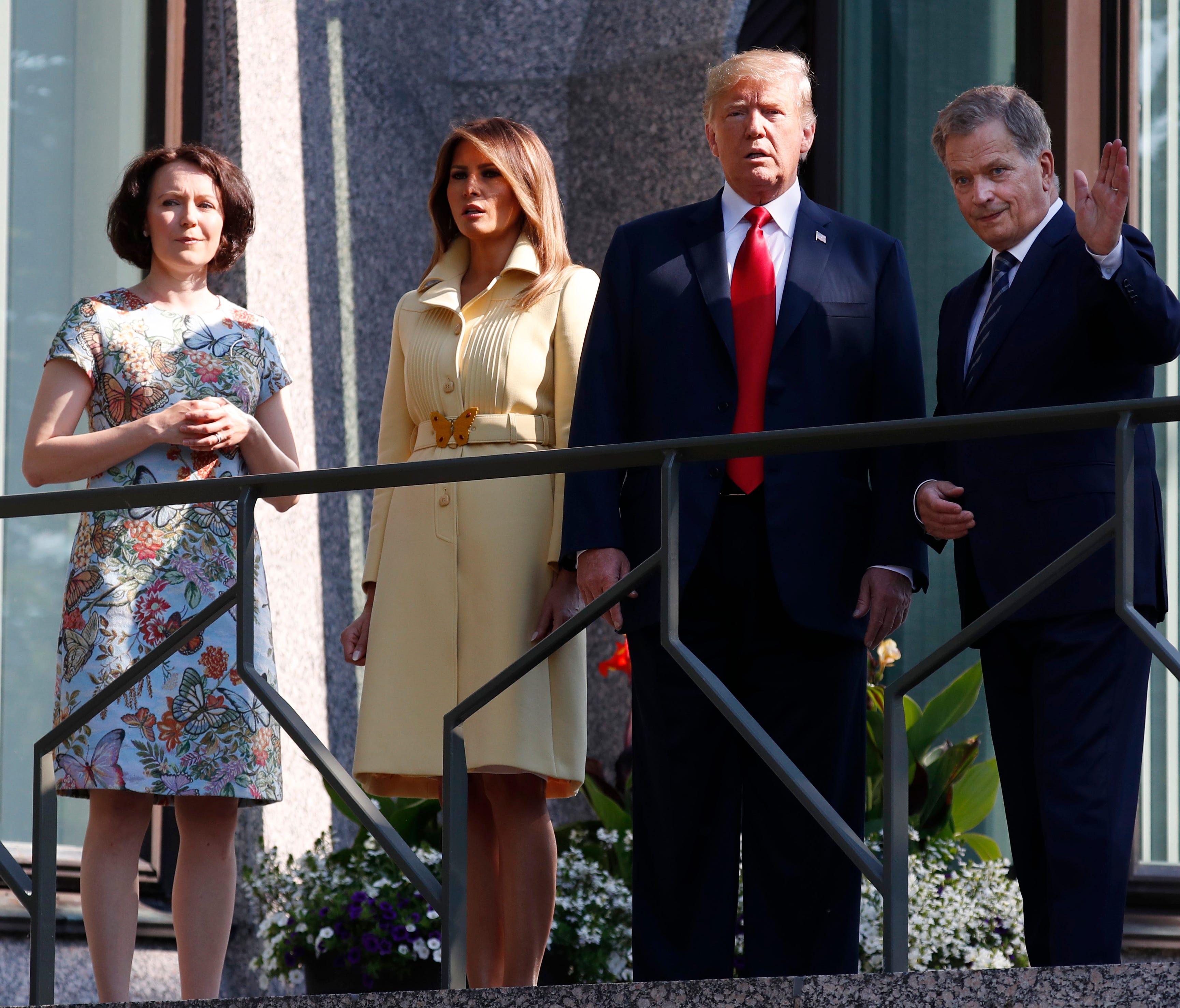Jenni Haukio, wife of Finnish President Sauli Niinisto, U.S. First Lady Melania Trump and President Trump and Finnish President Sauli Niinisto, from left, on the balcony of Niinisto's official residence in Helsinki on Monday.